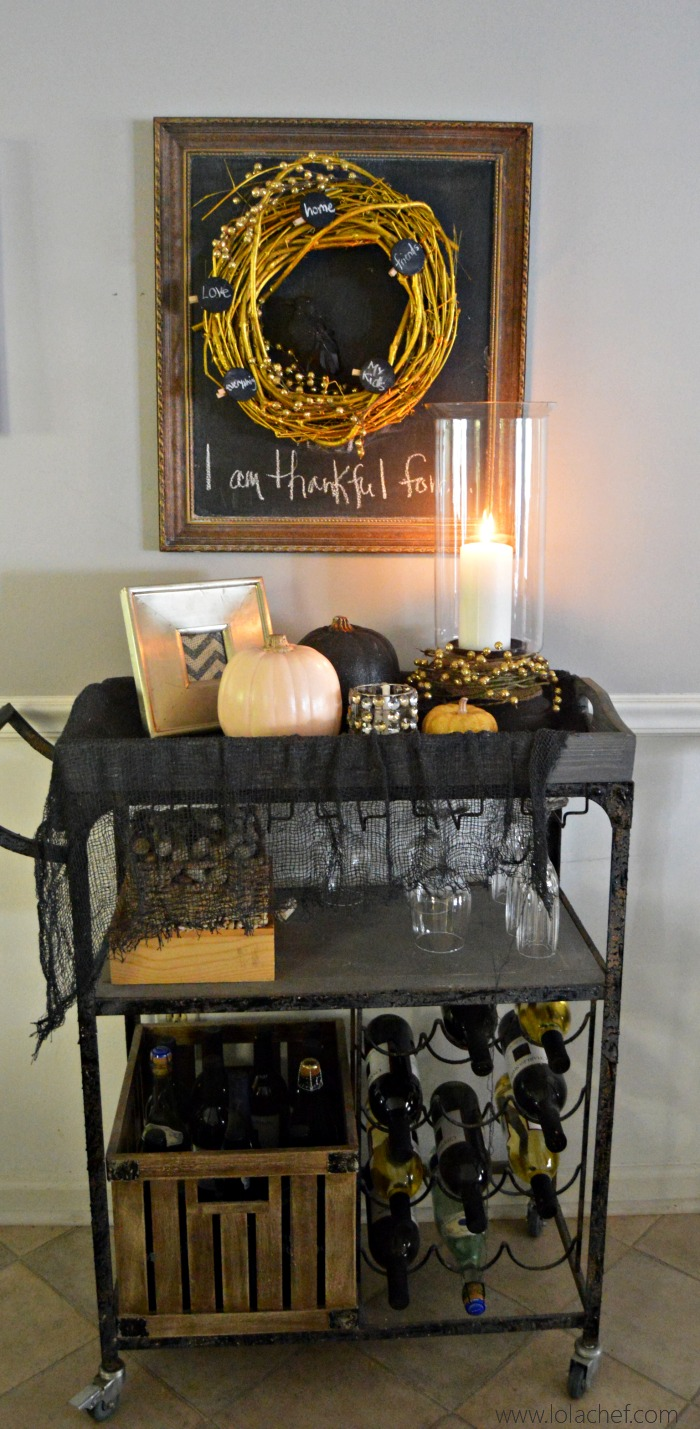 Give thanks this holiday season with this interactive gold wreath with chalkboard clips to write what you are thankful for.